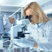 Female,Research,Scientist,Looks,At,Biological,Samples,Under,Microscope.,She
